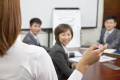 Businesswoman Speaking at a Meeting Stock Photos