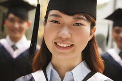 Young Graduates in Cap and Gown Stock Photos