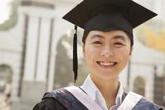 Young Graduate in Cap and Gown Stock Photos