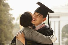 Mother and Graduate Hug Stock Photos