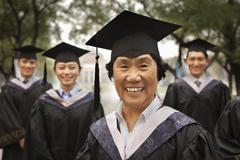 Professor and Graduates - stock photo