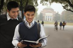 Two University Students on Campus - stock photo