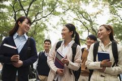 Group of University Students on Campus Stock Photos