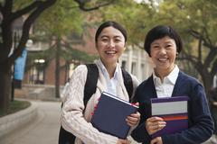 University Student and Professor on Campus - stock photo