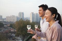 Couple Looking Out Over Cityscape Stock Photos
