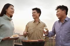 Friends Drinking Over a Barbecue - stock photo