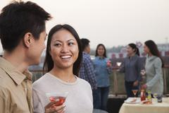 Stock Photo of Friends Drinking on Rooftop