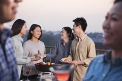 Friends Drinking on Rooftop - stock photo