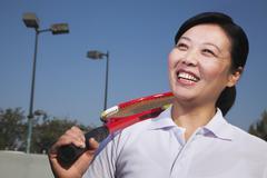 Mature woman playing tennis, portrait - stock photo