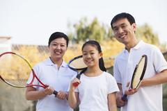 Perhe pelaa tennistä, muotokuva Kuvituskuvat
