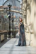 pretty young woman in a fashionable flutter transparent cape at old fashioned - stock photo