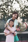 Mother and daughter playing tennis, portrait Stock Photos