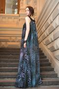 Charming sensual young woman in gauzy lengthy dress on stairs Stock Photos