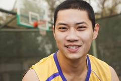 Young man on the basketball court, portrait - stock photo