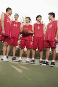 Basketball team standing and smiling, portrait - stock photo