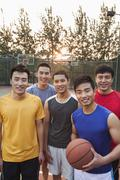 Friends on the basketball court, portrait - stock photo