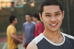 Friends on the basketball court, portrait Stock Photos