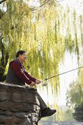 Senior fishing at lake Stock Photos