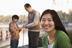 Portrait of mother with family fishing at a lake Stock Photos