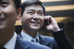 Businessman on the phone, Beijing, indoors - stock photo