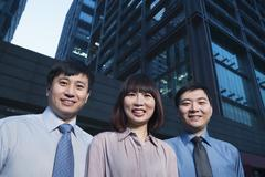 Stock Photo of Portrait of three-business people outdoors, Beijing