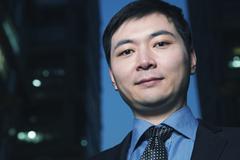 Portrait of businessman at dusk, Beijing Stock Photos