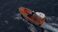 Mediterranean, rescue boat on ocean, picks up speed Stock Footage