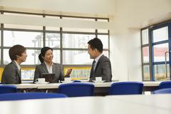 Business meeting in company cafeteria Stock Photos