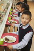 School children standing in line in school cafeteria Stock Photos