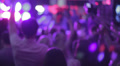 Waving hands in night club's crowd. People enjoying the party HD Footage