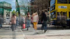 Time-lapse people crossing across busy traffic in downtown. 4K. Stock Footage