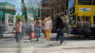 Stock Video Footage of Time-lapse people crossing across busy traffic in downtown. 4K.