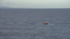 Mediterranean, rescue boat inspects life raft long shot - stock footage
