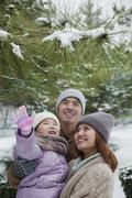 Family exploring in park in winter - stock photo
