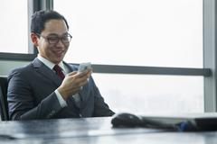 Businessman Using Mobile Phone Stock Photos