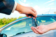 Sales manager sends the keys to a new car Stock Photos