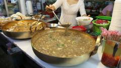 Asian Lady Scooping Noodles And Vegetable Soup Stock Footage