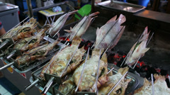Fresh Fish Grilled Over Fire In Bangkok Thailand Stock Footage