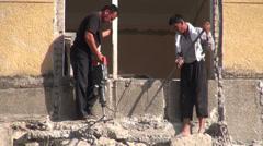 Old Soviet apartment, demolition, destruction, jackhammer, danger, Uzbekistan Stock Footage