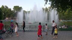 Families visit park in Uzbekistan town Stock Footage