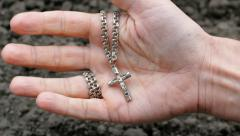 Hand Holding Cross Opens Closes HD Stock Footage