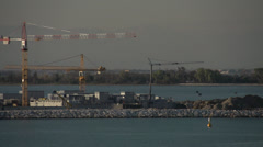 Venice MOSE project, construction cranes, Lido Lagoon medium shot, dolly Stock Footage
