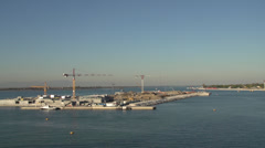 Venice MOSE project, construction cranes, Lido Lagoon entrance, dolly shot Stock Footage