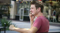 Young man having a phone conversasion outdoors Stock Footage