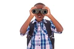 African american school boy using binoculars - black people Stock Photos