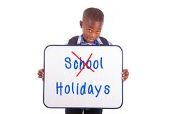 african american school boy holding a blank board - black people - stock photo