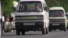 Traffic drives through Uzbek town Stock Footage
