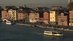 Venice dolly shot passing city bridge and boats, good skyline... Stock Footage