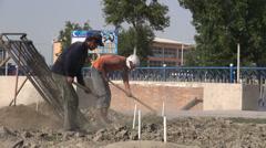Uzbekistan, construction, propaganda, corruption, workers Stock Footage