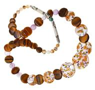 Necklace from nacre, tigers eye, carved bone Stock Photos